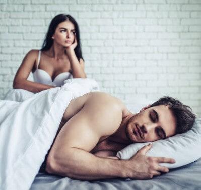 man sleeping, woman in bed
