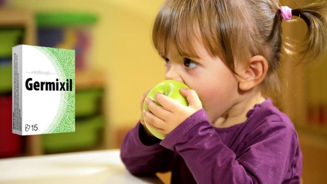Germixil - child eating an apple